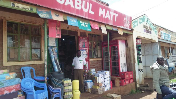Mr. Matthew Kiptanui standing at the door of his shop where thieves broke into