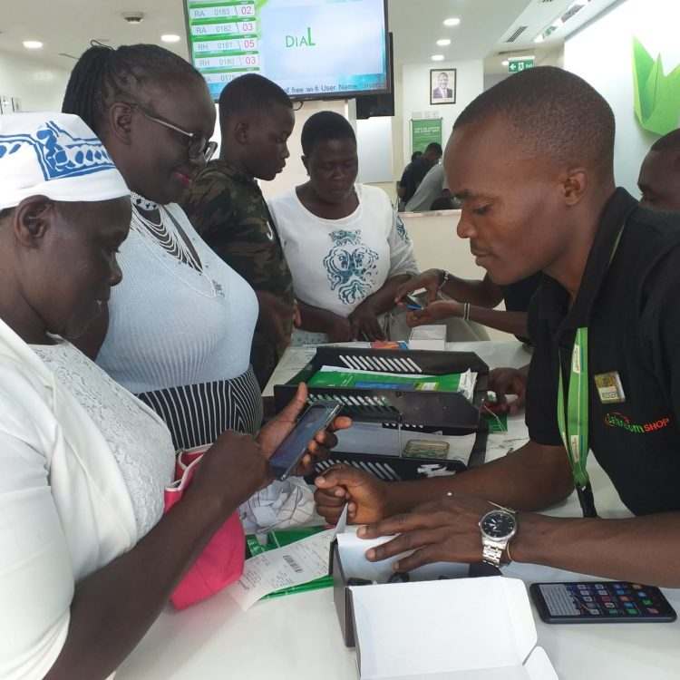 A customer being served by Safaricom staff