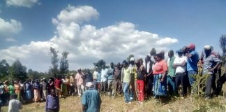 Mapera residents at the scene where the body was discovered