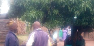 Munyama residents at the home of George Samba Sambili after he committed suicide