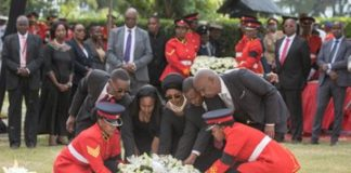 The Moi family members laying a wreath at the grave of the late retired President Daniel Moi. Photo/PSCU