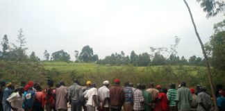 Bondeni residents at the bank of Kipkaren River where the body was found