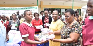 Girls receiving sanitary towels among other items from Kakamega first lady Priscillah Oparanya and Health CEC Rachel Okumu