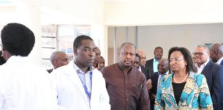 Health CS Mutahi Kagwe (centre) during the launch of the KNH Covid-19 treatment and isolation facility