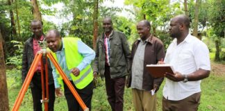 Chief Officer Moses Weunda (doing the check) commissioning the project.