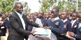Nandi Governor Stephen Sang handing over some of the items to the affected students