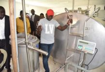 Nandi Governor Stephen Sang inspecting the Kabunyeria dairy cooperative society during his visit to Tindiret constituency