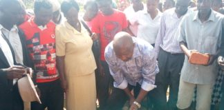 Lugari MP Ayub Savula digging the foundation of the construction of three classrooms at Nzoia Bridge primary school