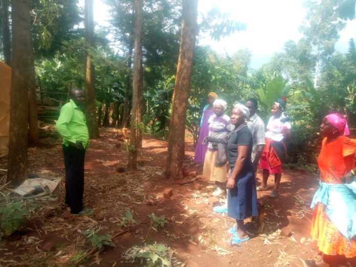 The deceased's family at the spot where he was struck by lightning