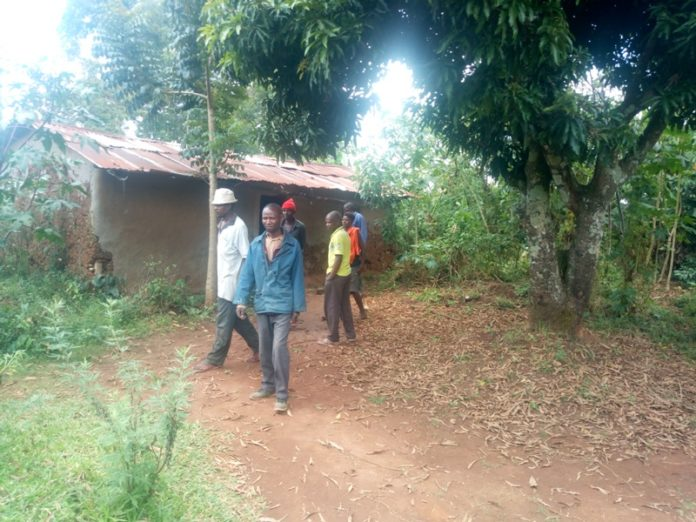 Milembe residents at the deceased's compound