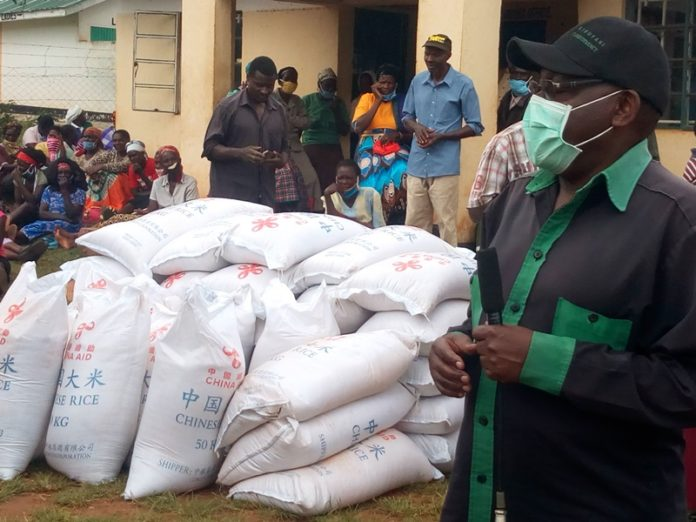 Likuyani MP Dr. Enoch Kibunguchy addressing residents during the distribution of food to flood victims