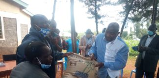 Lugari MP Ayub Savula when he donated food to the floods victims in Likuyani