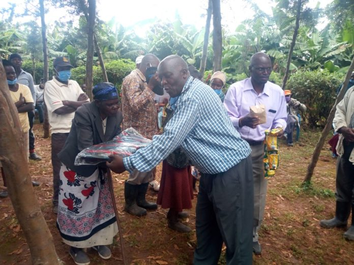 One of the flood victims receives a blanket donated by Dr. Evans Taracha