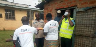 Police officers receive soap and face masks donated by Etale
