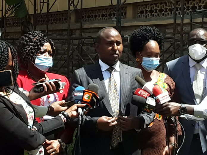 Suna East MP Junet Mohammed addressing the media at parliament buildings accompanied by a few other ODM legislators.