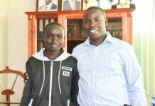 Nandi Governor Stephen Sang with Abiud Kipkurui from Serengonik who scored 430 marks in 2020 KCPE (file photo)