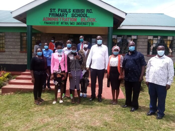 Moi University fraternity led by Prof. Kosgei at St. Paul's Kibisi primary school