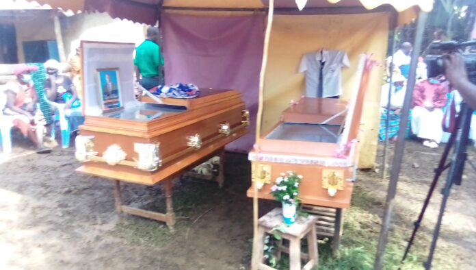 Caskets carrying the bodies of Munyendo and his daughter