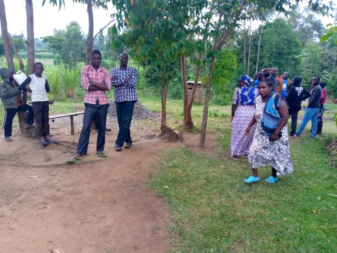 Mourners at the home of Anthony Keya after he committed suicide