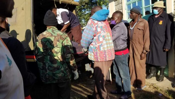 The bodies being taken by Matete police officers to the mortuary